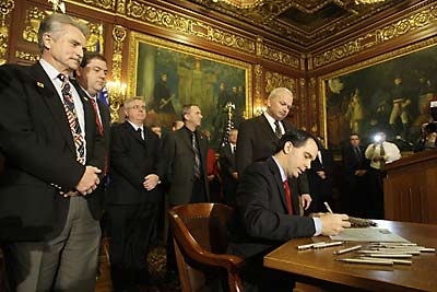 Walker Signing Bill